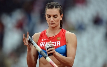 Russia's Yelena Isinbayeva sprays an adh...Russia's Yelena Isinbayeva sprays an adhesive spray on her pole prior to competing in the women's pole vault final at the athletics event of the London 2012 Olympic Games on August 6, 2012 in London. AFP PHOTO / FRANCK FIFEFRANCK FIFE/AFP/GettyImages